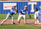 Copperas Cove senior Bryce Delano slides into second base as Temple's Reid Hesse and Ricky Ortiz await the throw during the first inning of Friday's game at Temple. The Wildcats edged the Bulldawgs 4-2.