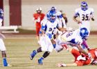 Copperas Cove senor defensive end Tyrell Thompson (88) prevents Belton quarterback Shane Stafford from recovering a bad snap in the fourth quarter as senior linebacker Justin Joe (7) charges in for the scoop and score. The Bulldawg defense scored 14 points in their 42-21 win over Belton on Friday. Jaylen Waters (35), shown in background, had a scoop and score in the second period. Thompson forced both turnovers.