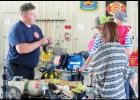 CCLP/J.S. FREDERICK - Firefighter/Paramedic John Burgan explains the equipment to citizens as they take a tour of Central Fire Station Saturday morning. Partnering with Benny Boyd of Lampasas the department raised more than $4,800 during the open house.