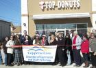 Members of the Copperas Cove Chamber of Commerce celebrate the opening of Top Donuts' second location in Copperas Cove.