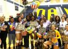 Copperas Cove seniors (not in this order) Mikayla Blount, Lexi Perez, Savannah Cook, Shana Young, Lily Drever, Ciara Cheadle, Destinee Branch and Raelynn Morris-Utu pose for a picture with their loved ones for senior night after sweeping the Belton Lady Tigers on Friday. The Lady Dawgs will play Rockwall in the Bidistrict round of the 2014 playoffs this Tuesday at 7 p.m. at Corsicana High School.